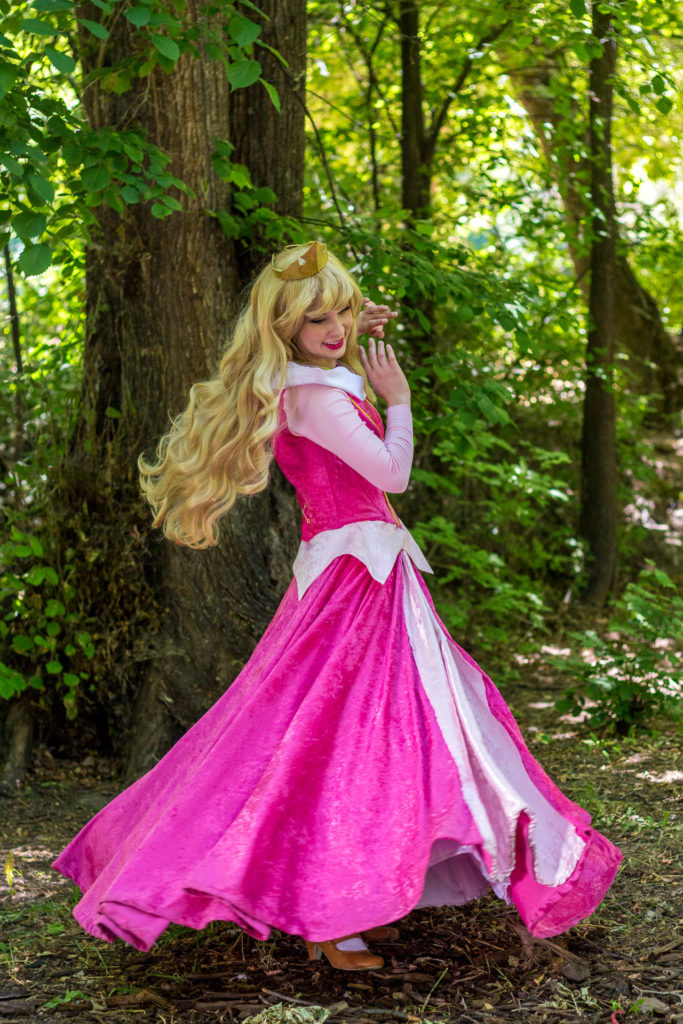 Princess Aurora twirling in the woods